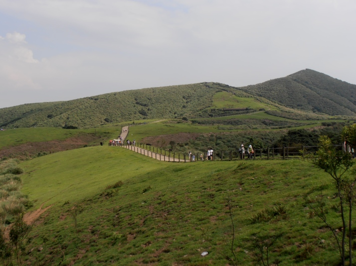 trail through the cow meadow with Mt Zhugao on the right