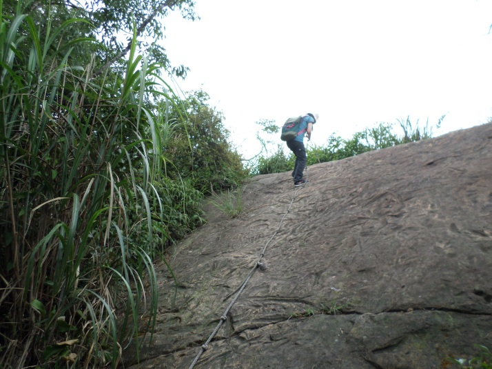 use the rope to climb down the rock face