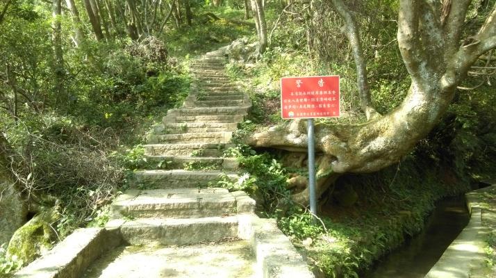 trail crossing a water channel