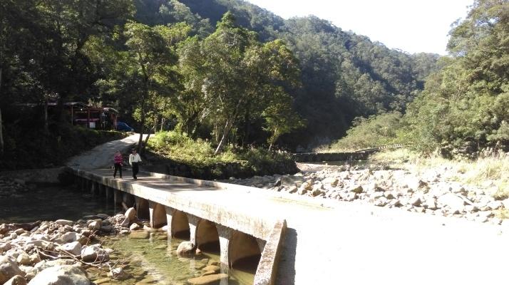 cross the bridge where the two large streams merge
